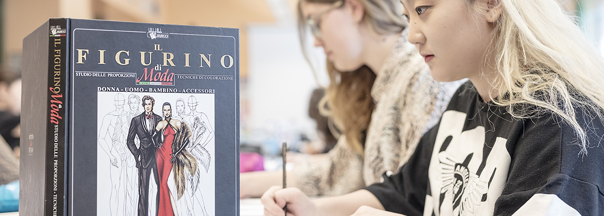 Students in fashion design colouring class